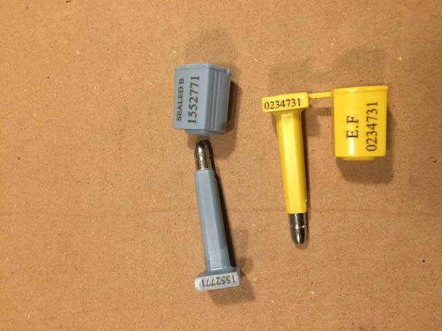 Forseglingsplugger av container